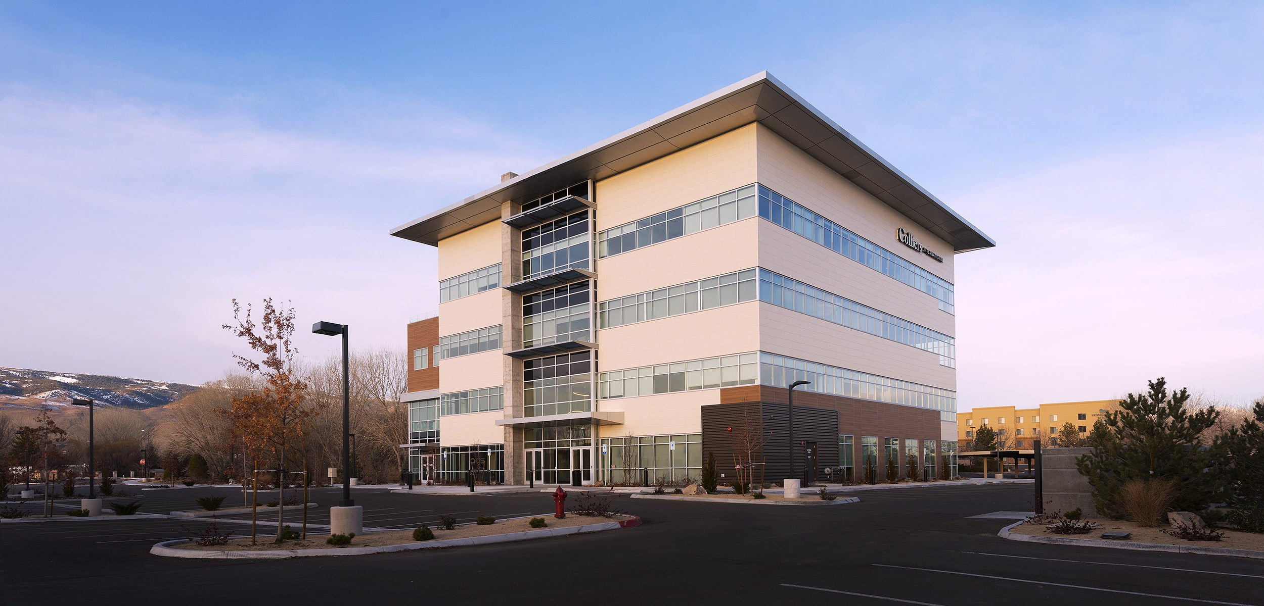 MVCC is a mid-rise office building in South Reno with an atrium, plaza, and overlook decks.
